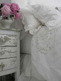 Love this bedding against the chippy furniture with beautiful pink peonies