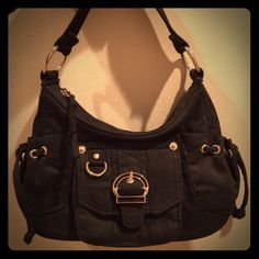 """Black Baguette Adorable black baguette.  EUC.  100% cotton.  Single strap.  Zippered closure.  Front, side and rear pockets.  Key clip.  Interior has a zippered pocket.  7"""" strap drop.  8x3x5.  This bag is too cute!❤️❤️ Bags Mini Bags"""