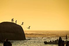 Photo and caption by Slawek Kozdras / National Geographic Traveler Photo Contest Boys in Clifton Beach in Cape Town jumping into the Atlantic Ocean.