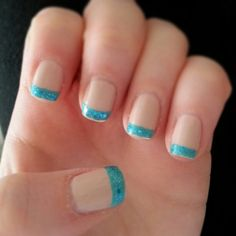 CarolJeanne's nude and turquoise French manicure.