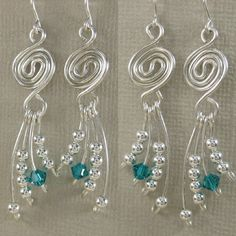 Love these swirly wire earrings with dangly wire wrapped | http://newjewelrytrends565.blogspot.com