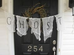 ghostly banner...i'm definitely going to do this in my place next year!!!  ADORABLE... ghosts and witches, doesn't get any better!