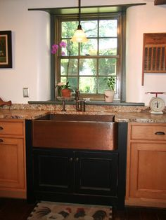 The dark cabinet accents the copper sink so well. I would not hesitate to do this. yes, in a second!!