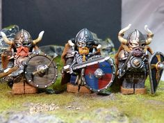 Awesome!  There's no better way to describe these custom Lego Viking minifigs.  The painting on the Viking Armor, Viking Helmet, Ram Horns, Kite Shield, and Viking shields is amazing.  And I love the chipped details he was able to add to the Viking Longsword and Axe.  The background is a perfect fit.  The beards are freaking awesome.  And the capes are a great addition.  Just amazing work! #Lego #BrickWarriors #Minifigure #Viking #weapons #swords #shields #axes #LegoViking #Legoweapons