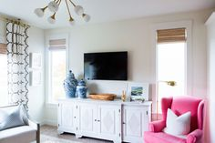 A pop of color with a pink armchair: http://www.stylemepretty.com/living/2016/04/12/color-happy-home-that-pantone-would-drool-over/ | Photography: Kate Osborne - http://kateosbornephotography.com/index2.php#!/h_o_m_e
