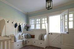 A Dutch door, wall of windows and beatifully detailed built-ins makes this generously sized mudroom an inviting space. By BHDM Design, via House of Turquoise. House Of Turquoise, Turquoise Walls, Home Interior, Interior Decorating, Interior Design, Decorating Ideas, Style At Home, Sweet Home, Handmade Home