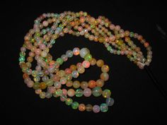 """119 Ct 17"""" Superb Fire Play Natural Ethiopian Welo Opal Round Beads 3 Strands by 9GemsCreation on Etsy https://www.etsy.com/listing/234979605/119-ct-17-superb-fire-play-natural"""