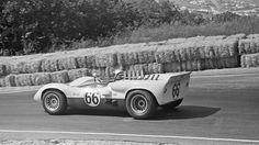 "From May of 1965, when this Chaparral raced at Laguna Seca in the USRRC, to September, the car evolved quickly. This car did not have the front ""mustache"" spoilers that debuted at Riverside in June. The transom shows none of the screening that would appear within 90 days of this race. The left side cooler scoop shrinks and then goes away by late September. Tires are about 3 inches narrower than we see in September. No louvers. The rear spoiler is small relative to late cars. Bill Hewitt…"