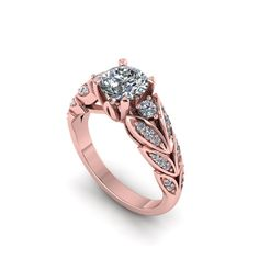 hand made rose gold diamond engagement ring by fabiandiamonds