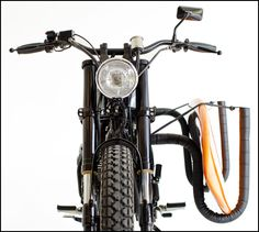 @Devin Hunt Hunt Hunt Fish ....yes, that is indeed a motorcycle with a surfboard carrier :)