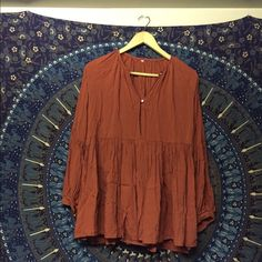 TUES SALE: Burnt orange flowy top/dress Hello! I received this flowy burnt orange dress/top from an Asian site and it's much much too small for me to ever wear. Very short. It's marked a size large- but an Asian size large. Would more recommend for size XXS/XS/S. Super sad that it doesn't fit because it's a cool design! If you're tiny, this would make a great bohemian addition to your wardrobe. Kinda reminds me of Free People. But not actually Free People. Just marked FP for exposure. Never…
