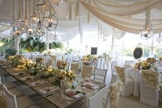 wedding tent decor -gorgeous! you can even use white king size sheets or yards of white organza!