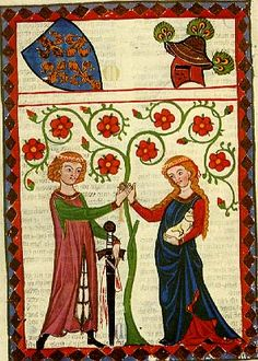Medieval. He is wearing a a tunic and a open mantle. She wears an under tunic and a closed mantle.