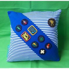 Memories of Girl Guides. I had most of these badges on my sash. So love the idea of making a pillow out of it!