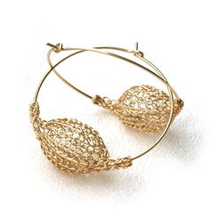 "Unique earrings design , a wire crochet element stringed on a wire Hoop . The hoop diameter is 1.5"" (3.8cm), the pod diameter is 0.6""(1.5cm) Both the pods and the hoops are 14k gold filled, the pods a"