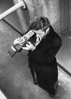 James Dean photographing with a Rolliflex in New York City.