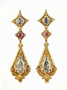 """Aquamarine & Ruby Earrings, 1850-60 - """"The gold has been stamped with relief decoration to give the impression of being more substantial than it really is. Before the discovery of rich gold deposits in California in the 1860s, the metal was very highly priced and such devices were employed even for pieces set with precious stones."""""""