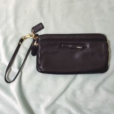 Coach large wristlet/wallet Authentic coach wristlet. 8 inches long. Fully zips with lots of inside pockets. Full zip outer pocket and an open outer pocket. Super cute bow design. Some wear along the front seam shown in 2nd picture. Very good condition. Real leather and very soft. Price is firm. Coach Bags Clutches & Wristlets