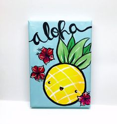 This kawaii painting measures 5 x 7 and is 3/4 deep. It was painted on a stretched canvas in acrylic paint and features a kawaii pineapple and little hibiscus flowers. The background is a light blue and contrasts beautifully with the bright color of the pineapple and flowers. The word aloha scrolls across the top of the painting in black. The painting has a matte finish.