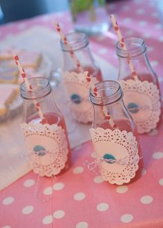 empty starbucks bottles + doily + button and twine = adorable
