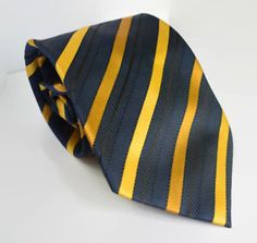 Men Necktie     Classic Cravat by Viye Ssori Milan-Italy  Type : Medium  Color : Dark Blue yellow striped  100% Polyester  Quantity : 1 Pc.  Measurement   Sword Width:  10 cm , 3.9 inch   Length : 152.4 cm , 60 inch