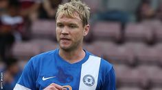 Peterborough midfielder Grant McCann to join Linfield