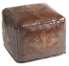 Leather Ottoman Fleur de Lys - A really unique ottoman to use as foot stool, extra seating or a fun accent piece. A hand tooled Fleur de Lys design is featured on top and sides.