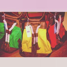 NEW ARRIVAL: Canvas rope totes. Featured in kelly green, lemon yellow, and sunkist orange. #mudpie #armcandy #fringe #hippie