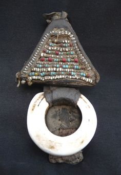 Africa | Old Tuareg Leather Talisman - Shells - Niger | Mid 20th century | These talismans are hung inside the tent. The triangle is a protection against evil eye; the shell is related to female fertility.