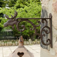 Durable decorative wall bracket crafted from cast iron complete with intricate scrolled detail and an attractive stag head.  Made from heavy weight cast iron, in a traditional antique brown finish, making this the perfect accessory to be displayed all year round.  Perfect for displaying seasonal hanging baskets by the front door.  A lovely gift idea for a 6th wedding anniversary or for a keen gardener!