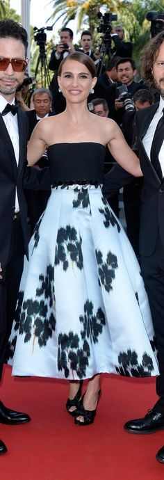 Natalie Portman looked lovely in a strapless black and powder blue printed Christian Dior Couture dress. The Spring 2015 design was played up by Natalie's diamond stud earrings and black pumps.