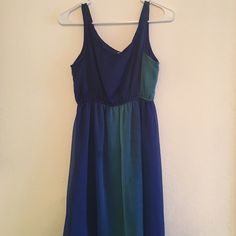 Flowy high/low blue dress This dress is great for a casual brunch or to go to the beach. It could also be dressed up with some wedges. Only worn a couple of times. Dresses High Low