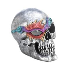 "by Dragon Crest This cool skull figurine features a silvery finish and a dazzling eye patch that will catch the attention of all who see it. The interior LED light makes one eye glow with spooky splendor. Two ""AA"" batteries not included. 5.5"" x 7"" x 6.5""  allgooddecor.com #allgooddecor #decor #candles #accents #figurines #furniture #gifts #decorations #lighting #mirrors #fountains #outdoor #toys"