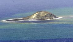 A partially eroded pumice cone formed during an eruption that began on August 7, 2006, is seen from the north on December 18. By the end of the year wave erosion had destroyed the cone. Floating dacitic pumice from this eruption traveled as far as Australia. Home Reef, a submarine volcano midway between Metis Shoal and Late Island in the central Tonga islands, was first reported active in the mid-19th century, when an ephemeral island formed. Eruptions in 1984 and 2006 also formed islands.