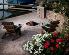 A small round fire pit is special addition to a dock area. The fire pit and patio area use Belgard materials.