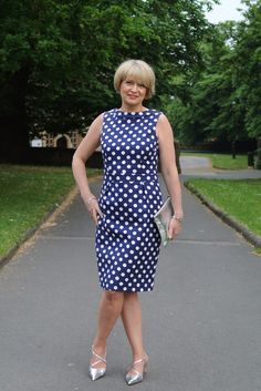 Another Summer day, another simple dress, this time for an after work garden party. The metallic accessories help to make it less conservative. Midlifechic is a style blog for women over 40.