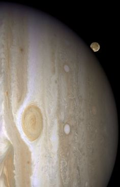 """Jupiter's Largest Moon Going to the 'Dark Side'   Jupiter's moon Ganymede playing a game of """"peek-a-boo."""" In this crisp Hubble image, Ganymede is shown just before it ducks behind the giant planet. Ganymede completes an orbit around Jupiter every seven days. Because Ganymede's orbit is tilted nearly edge-on to Earth, it routinely can be seen passing in front of and disappearing behind its giant host, only to reemerge later."""