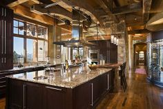 Huge island.  Not crazy about those cabinets, a bit too contemporary for the log setting