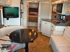 Another with white interior, Allegro Breeze Compact Class A Motorhome Interior