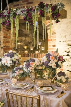 """The over all effect given off by the rich blooms and deep purple succulents in this """"Wedluxe"""" photo shoot by Dizennio Floral is one of luxuriant ambiance"""