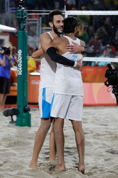 Paolo nicolai Photos - Daniele Lupo of Italy and Paolo Nicolai of Italy celebrate winning the beach volleyball Men's Semi final against Viacheslav Krasilnikov and Konstantin Semenov of Russia on Day 11 of the Rio 2016 Olympic Games at the Beach Volleyball Arena on August 16, 2016 in Rio de Janeiro, Brazil. - Beach Volleyball - Olympics: Day 11