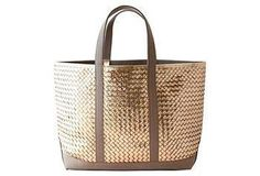 The handwoven and antiqued calfskin provides brilliant shine for this luxurious tote.