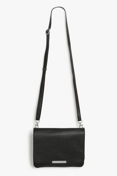 A classic and super handy LBP (Little Black Purse) cut from a textured faux 9eebd3cfeb8