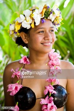 French Polynesia, Tahiti, Tahaa, Close-up of a young woman in traditional Polynesian dress