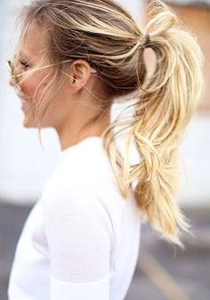 A loose, tousled ponytail looks effortlessly cool when paired with a basic button-up shirt. // #Hair