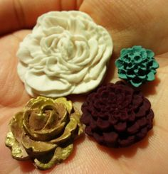 Dark Spring Flower Polymer Clay Cabochon Mix with  White Pompom, Dark Radiant Orchid mini pompom, Teal blue pom, and Painted Brown/Gold Rose by MuslimPenguin, $2.99  MuslimPenguin.Etsy.com Etsy.com