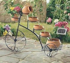 bicycle used for making a water fountain and garden decoration Uhles Van Winkle Myers Design Fonte, Water Fountain Design, Fountain Ideas, Garden Art, Home And Garden, Garden Fountains, Water Fountains, Fountain Garden, Outdoor Fountains