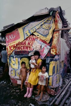 Smokey Mountain has a large squatter community in Manila, Philippines, and it is estimated that 30,000 people live near the site, and make their living from picking through the rubbish at Smokey Mountain.