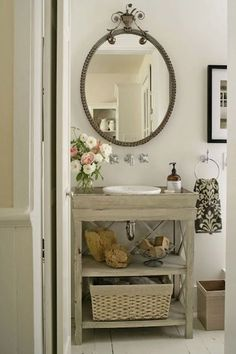 An ornate mirror and fresh flowers are perfect for a rustic bathroom. Click on image to see more rustic decor and DIY ideas.