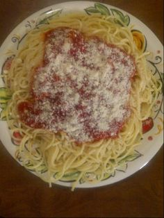 Spaghetti,Sauce and Grated Parmesean Cheese.